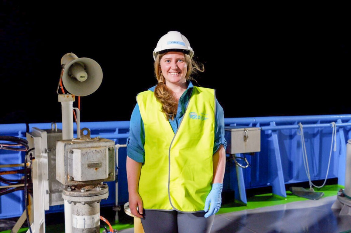 CSIRO researcher Karlie McDonald onboard RV Investigator at night wearing PPE gear.