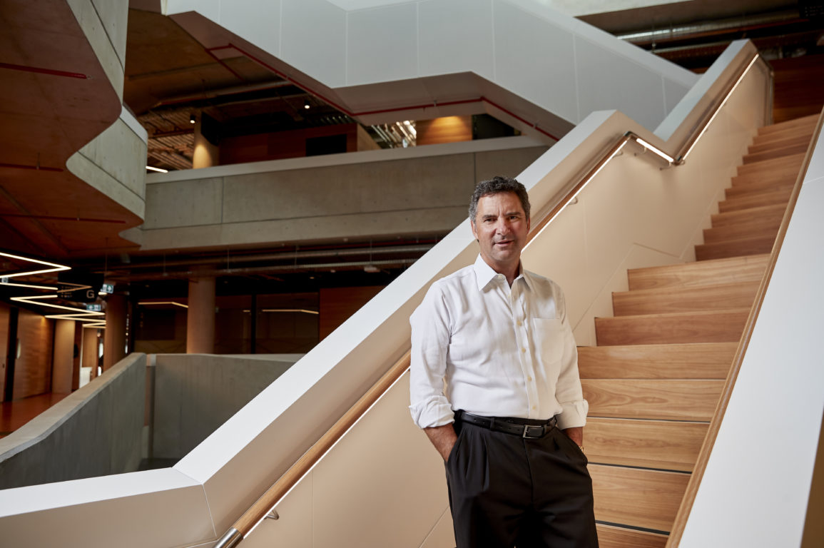 CSIRO Chief Executive, Larry Marshall standing in front of a staircase