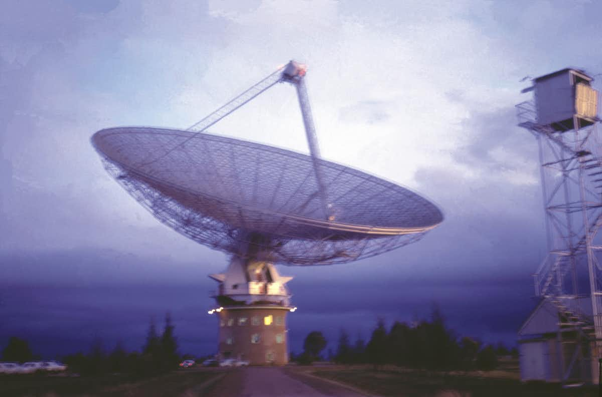 The Parkes radio telescope with the passing storm that almost stopped the dish from broadcasting the images from the Moon