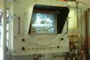 A close-up shot of the monitor showing the moonwalk signal from Apollo 11 as it happened