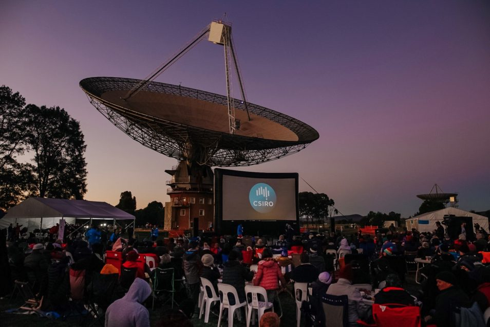 A movie screen showing the CSIRO logo in front of the Dish