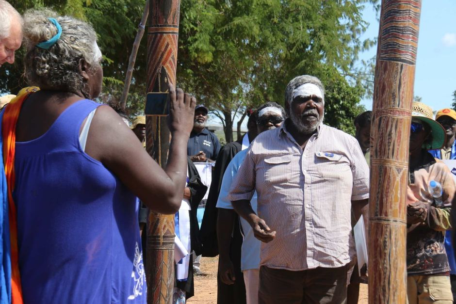A Baniyala traditional owner with his face painted addresses the community in Arnhem Land.