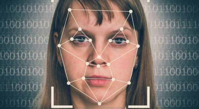 Woman with facial mapping technology edited over face.