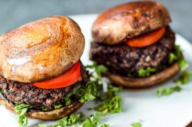 vegan burgers with mushroom 'buns'on a plate