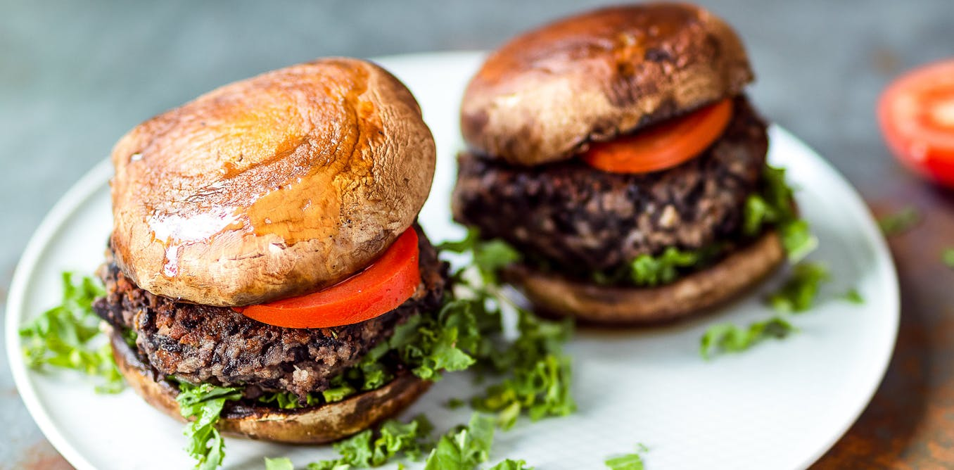 vegan burgers with mushroom 'buns'on a plate