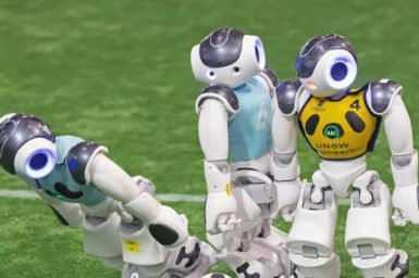 Robots playing soccer on a soccer field