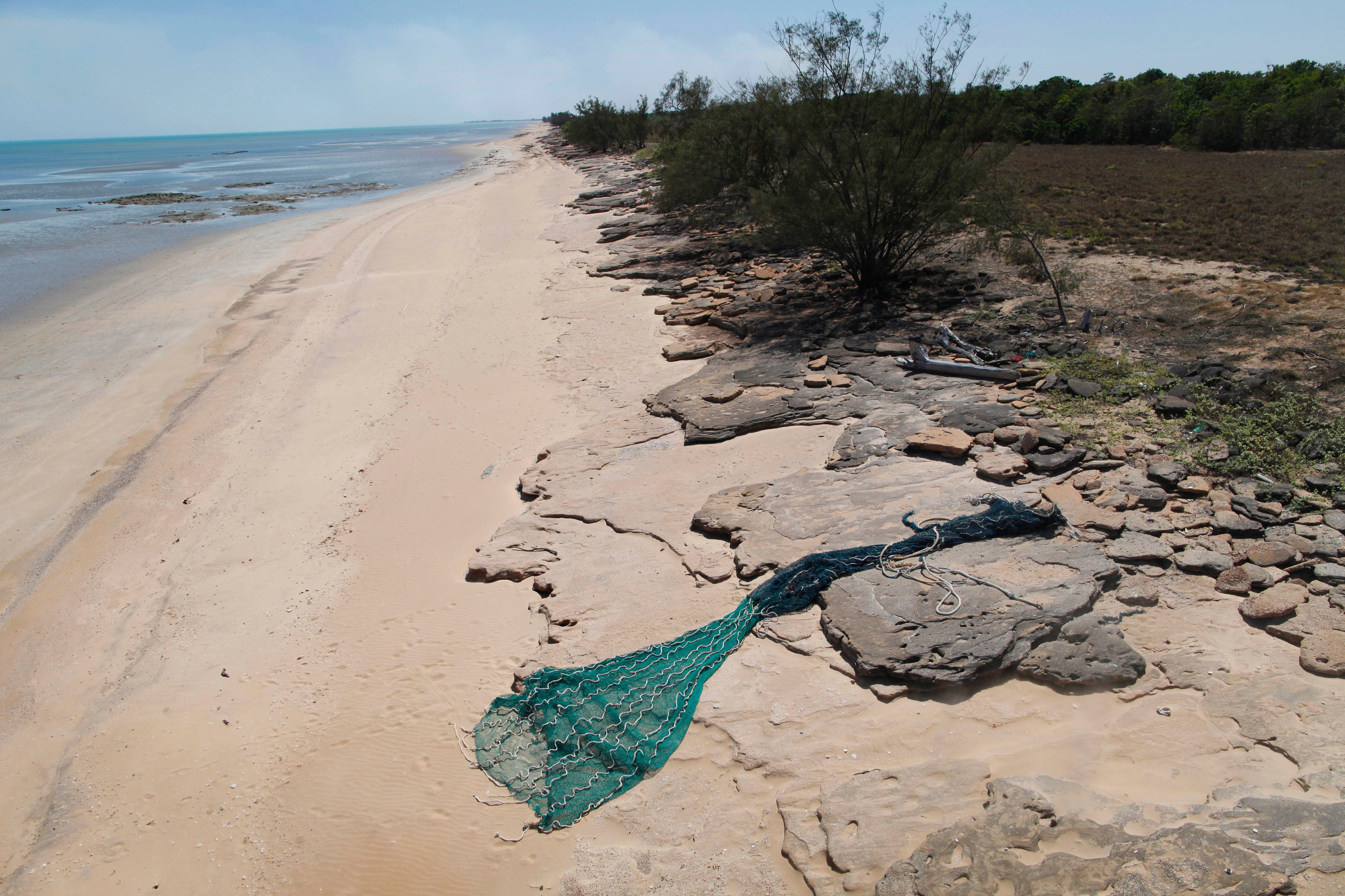 A fishing net washed up on a beach