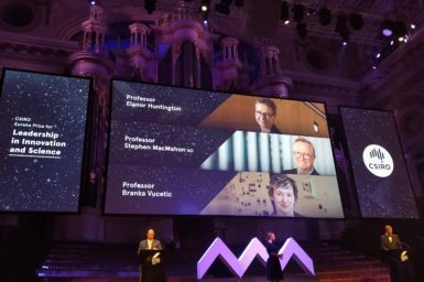 Leadership in Innovation and Science Award finalists shown on a screen at the Euerka Prizes event