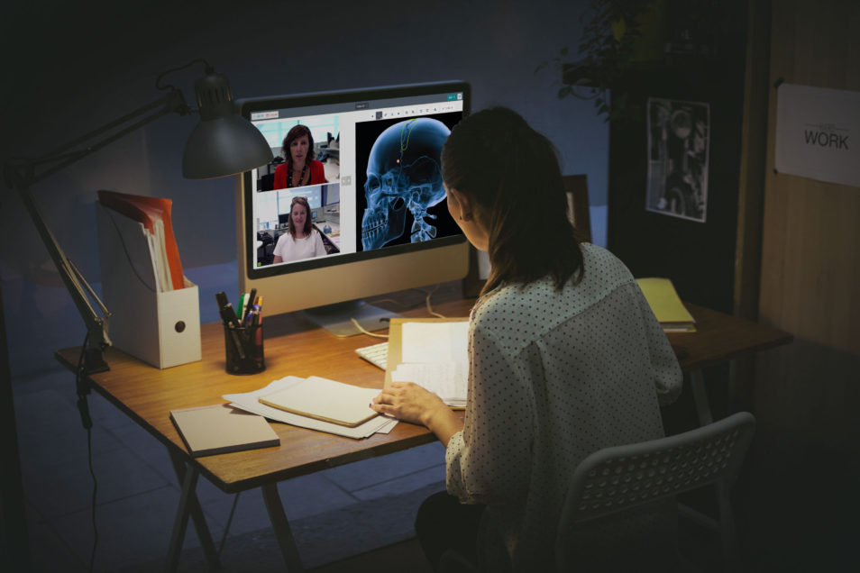 A person sitting at a desk using Coviu to talk with their medical professional.