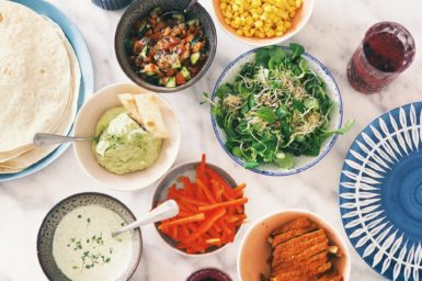 bowls and plates of healthy food on a table