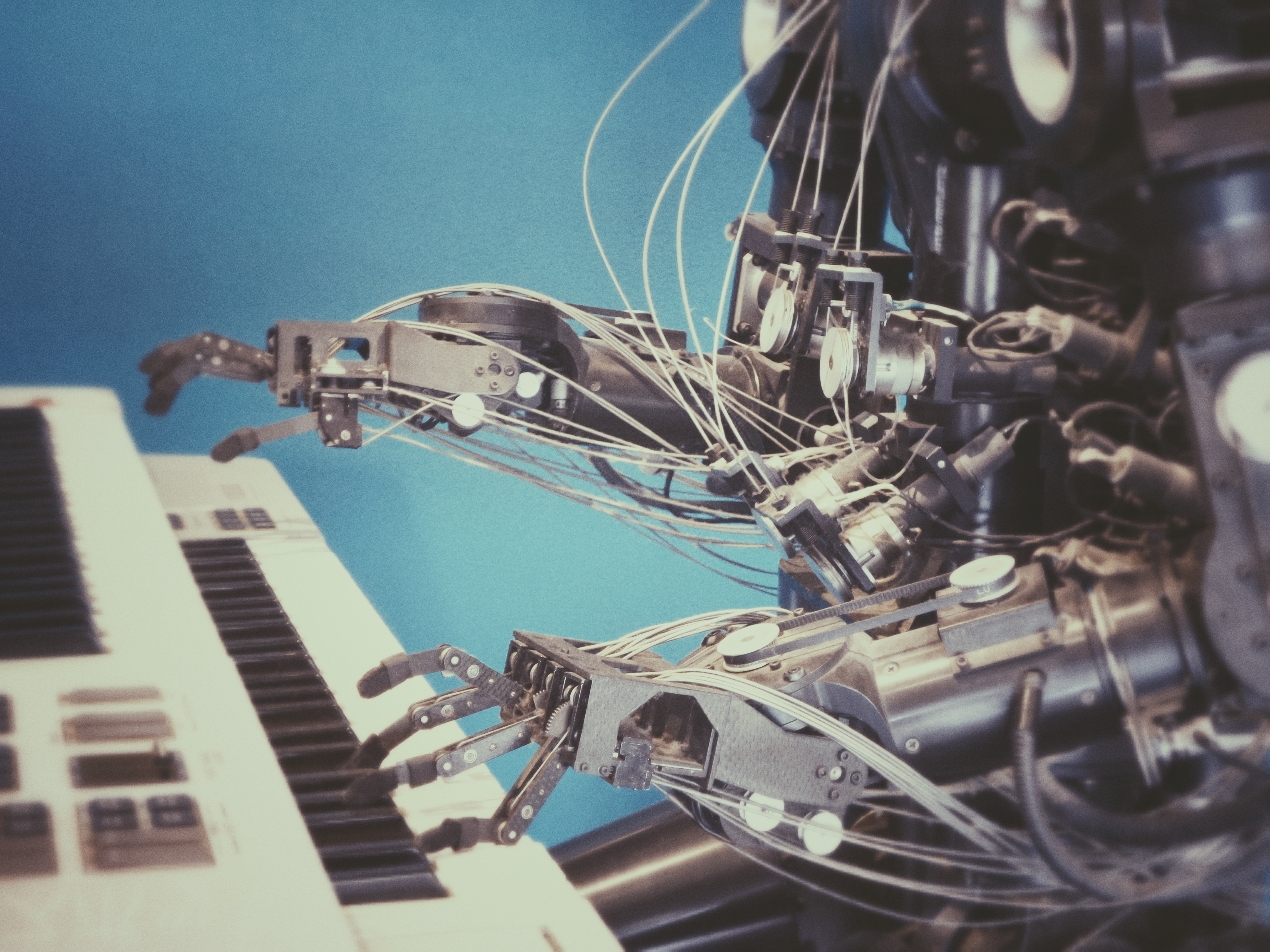 robot playing piano tech songs
