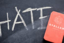 """Hate"" written on chalkboard with eraser branded with ""Stellargraph"" rubbing it out"