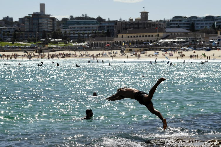 Person diving into the water at Bondi Beach