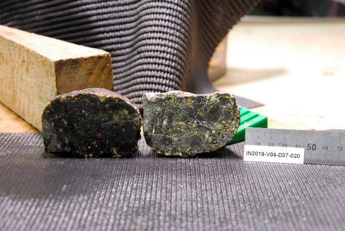 breccia measured against a ruler