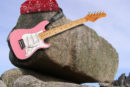 Photo of a rock playing rock songs with a bandana and electric guitar photoshopped on