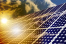 Sun shining on a solar panel
