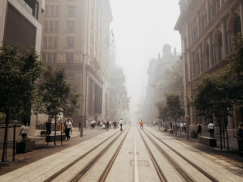 A smoke haze over a city street.