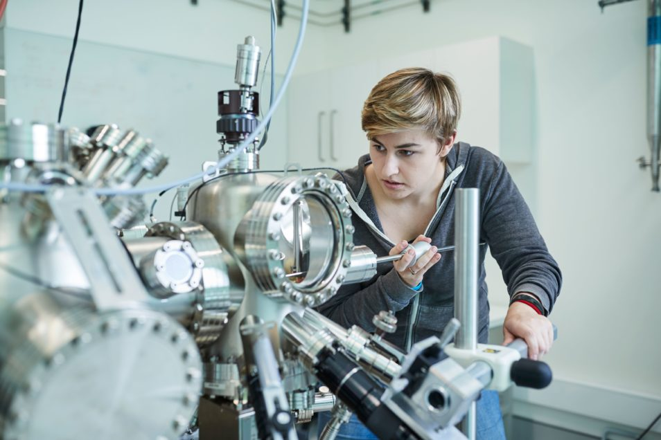 Woman working on quantum computer