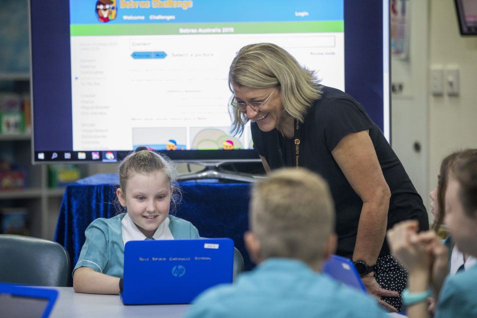Woman in classroom with students completing Bebas Challenge