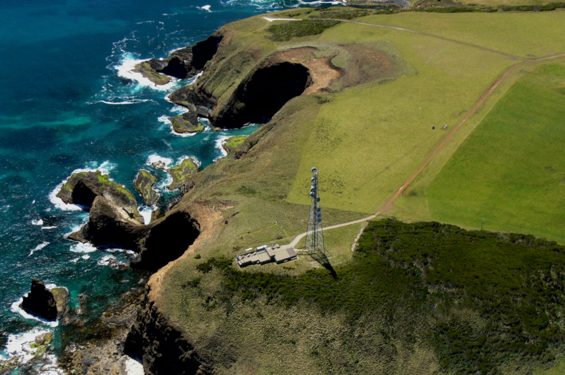 aerial view of the cape grim station on a cliff on the coast