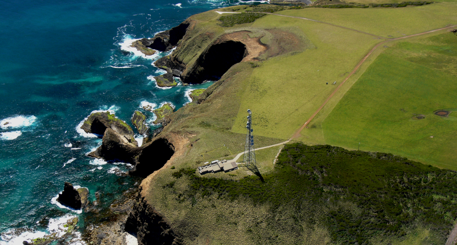 aerial view of the cape grim station on a cliff on the coast where we measure co2 emissions data