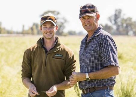 two farmers in a field