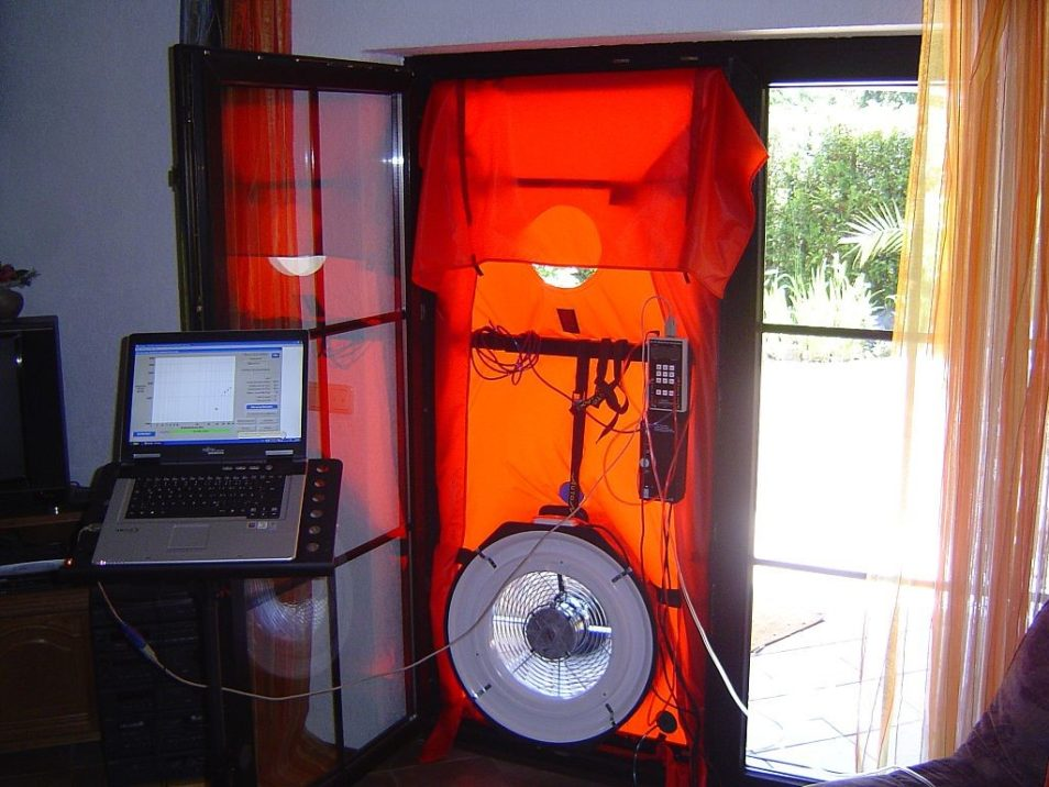 scientific fan placed in doorway with computer logging air movement to help draught proof house