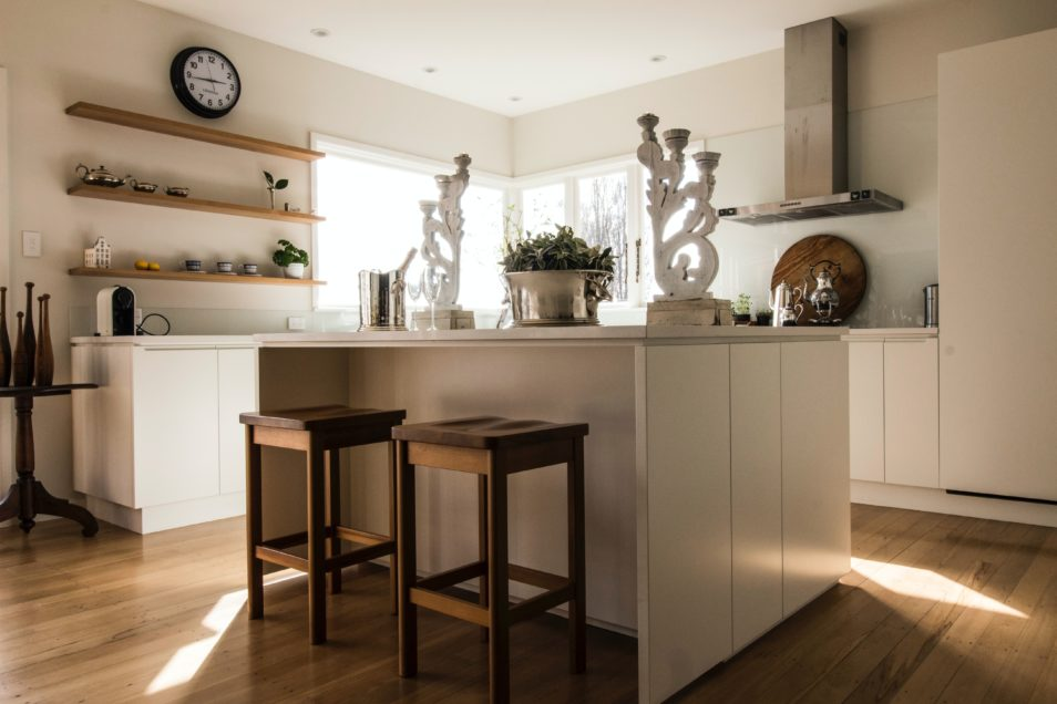kitchen with sun streaming in through windows