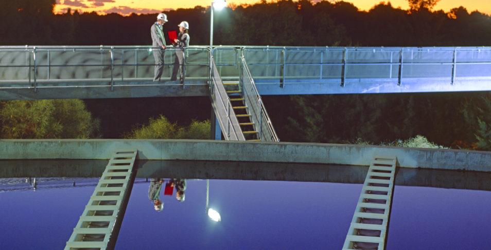 two people standing on a platform above a water treatment plant in Perth