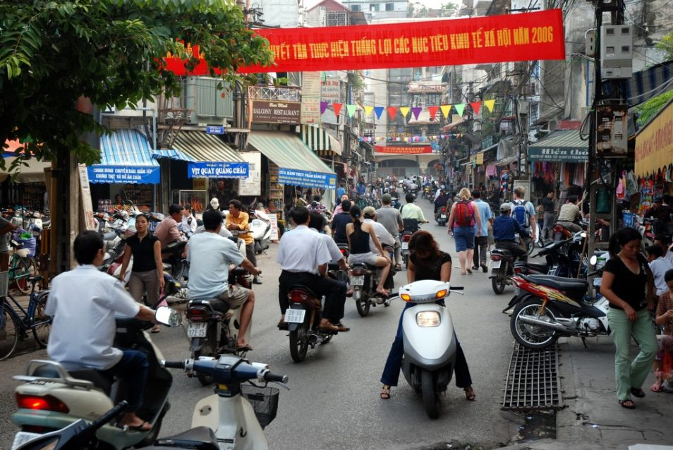 people on motorbikes in hanoi, vietnam