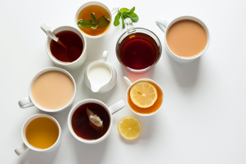 A aerial shot of different mugs of hot liquid.