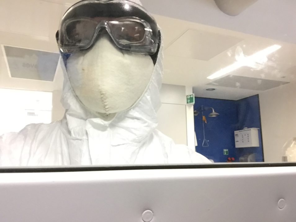 Dr Jurg Schutz wearing a lot of PPE in a lab.