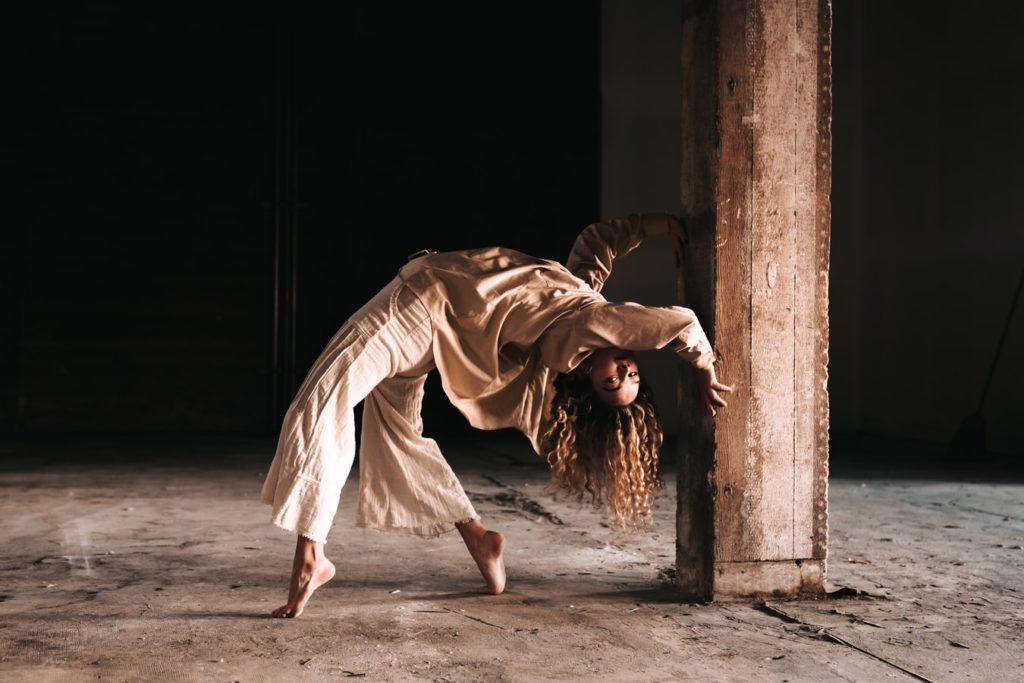 lady dancing in a warehouse music you can move to