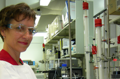 Lesley Pearce stands in a lab wearing protection gear.