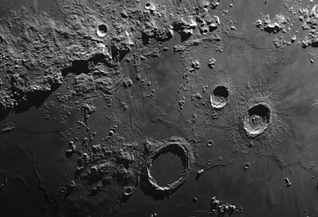 A close up of craters on the Moon.