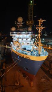 RV Investigator at night with lights on deck