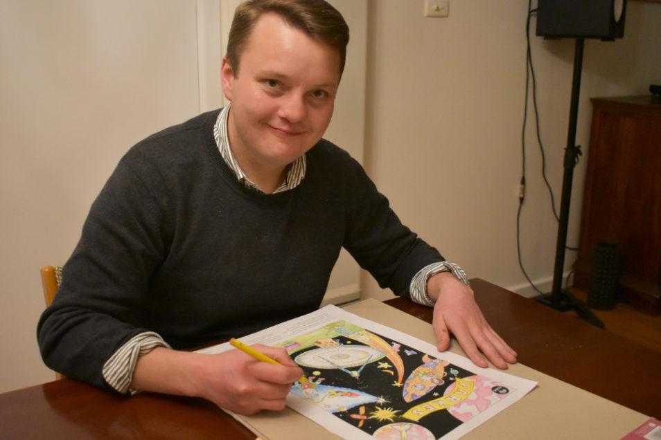 Illustrator Henry colouring in his artwork