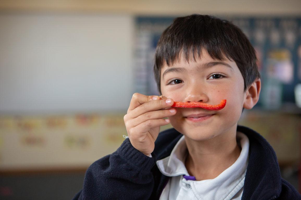 boy holding a capsicum
