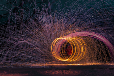 A timelapse photo shows sparks flying