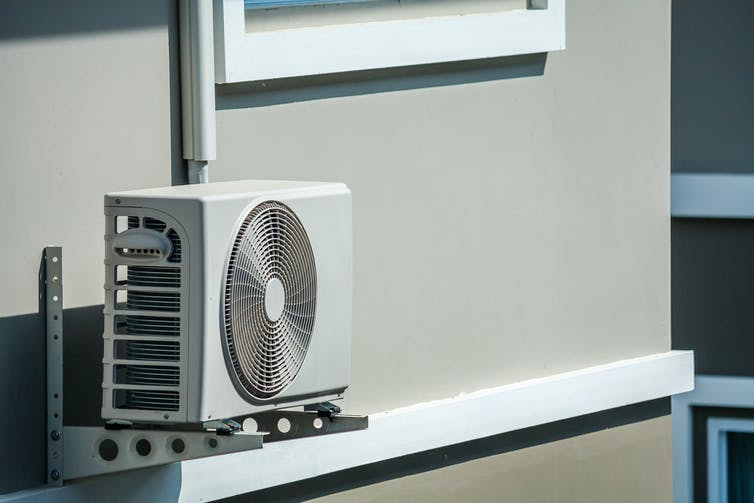 A split system airconditioner attached to a wall.