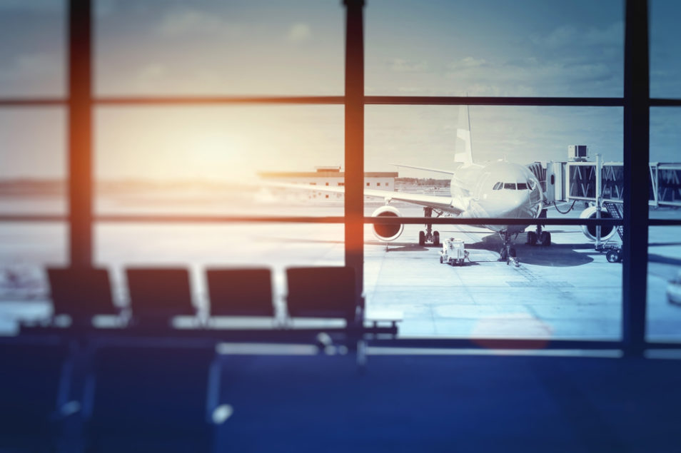 aeroplane waiting for departure in airport terminal, blurred horizontal background