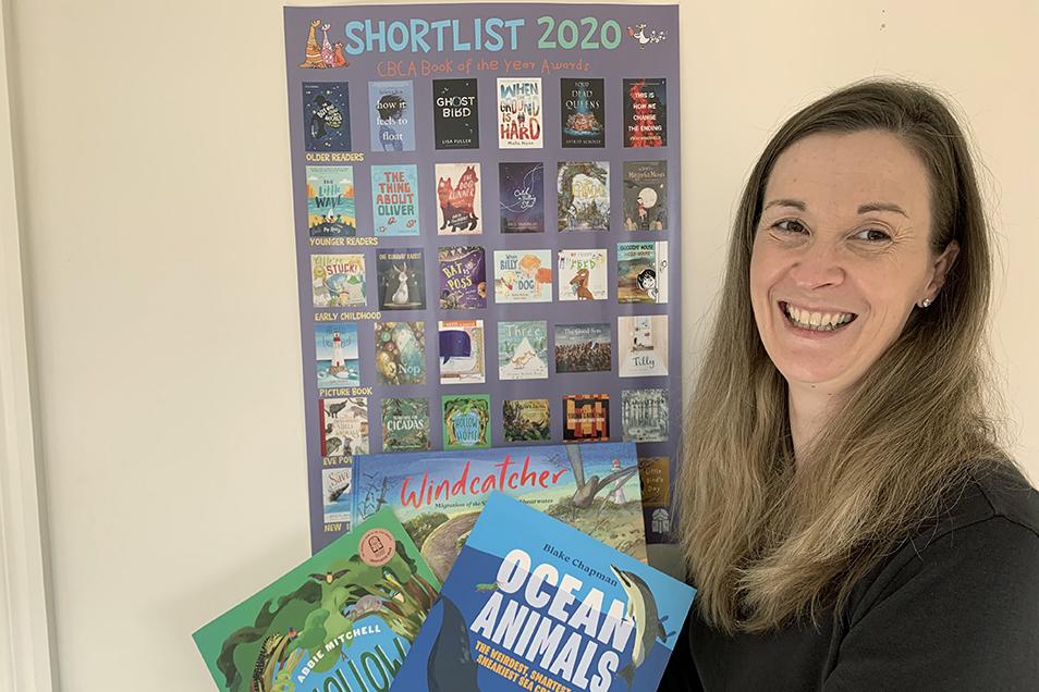 Briana holds up three CSIRO Publishing books
