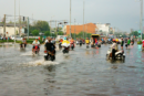 Residents in Ho Chi Minh City travelling through the streets on motorbikes on a day of flooding in the city.