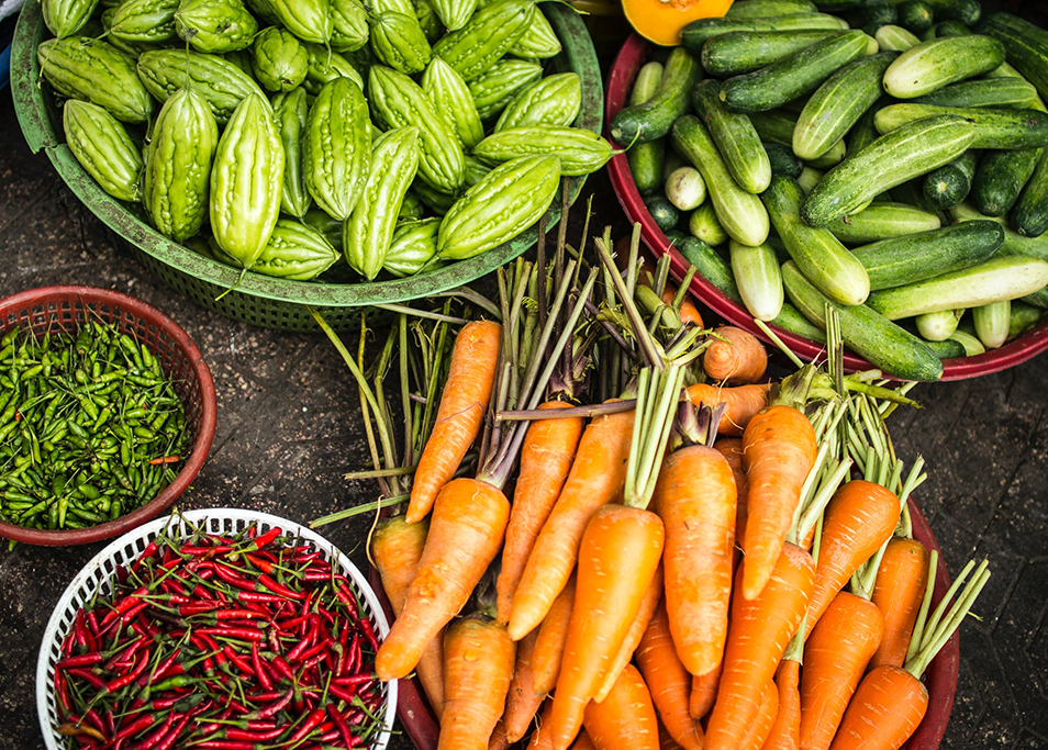 Vietnam's environmental challenges face the agriculture sector. This is an image of colourful Vietnamese fruit and vegetables.