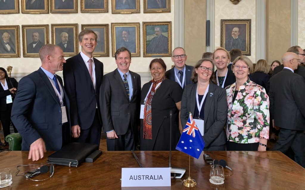 Sarah Pearce (third from left) standing with a group of people negotiated the international treaty on behalf of Australia.