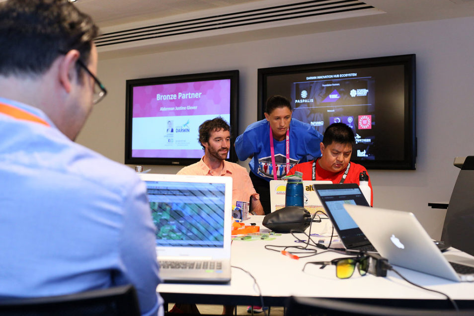 GovHack 2020 with hackers working around computers