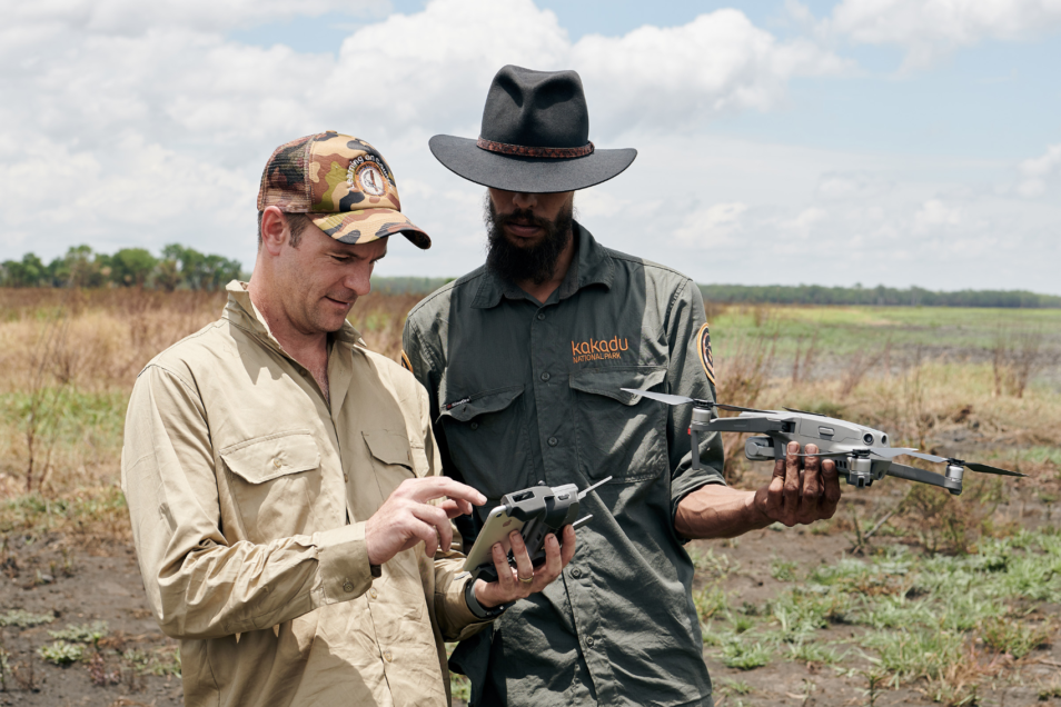 Justin perry looking at a drone with Indigenous ranger Kadeem May