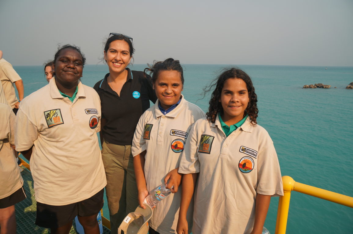Marlee Hutton standing on a jetty with Broome Senior High School Bushrangers on the Ey