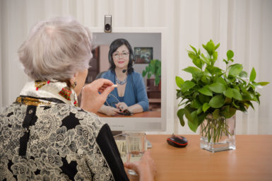 An older Australian talking to their doctor through video call.