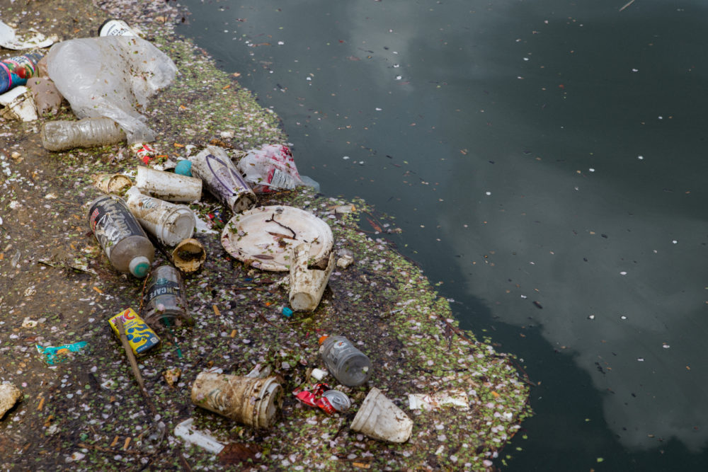 PLASTICS FLOATING IN A RIVER